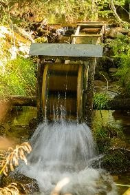 Water gushing out of a spinning water wheel